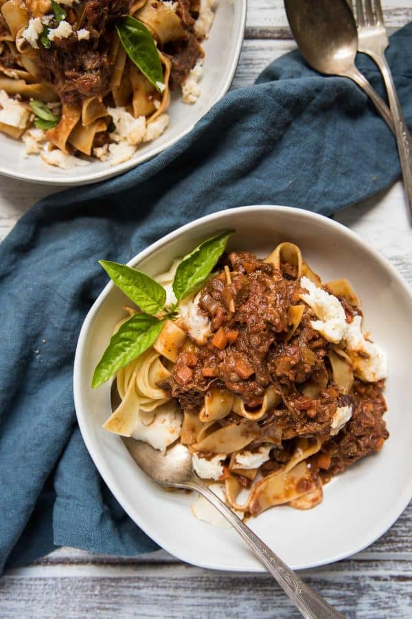 overhead view of short rib bolognese tossed with pappardelle pasta