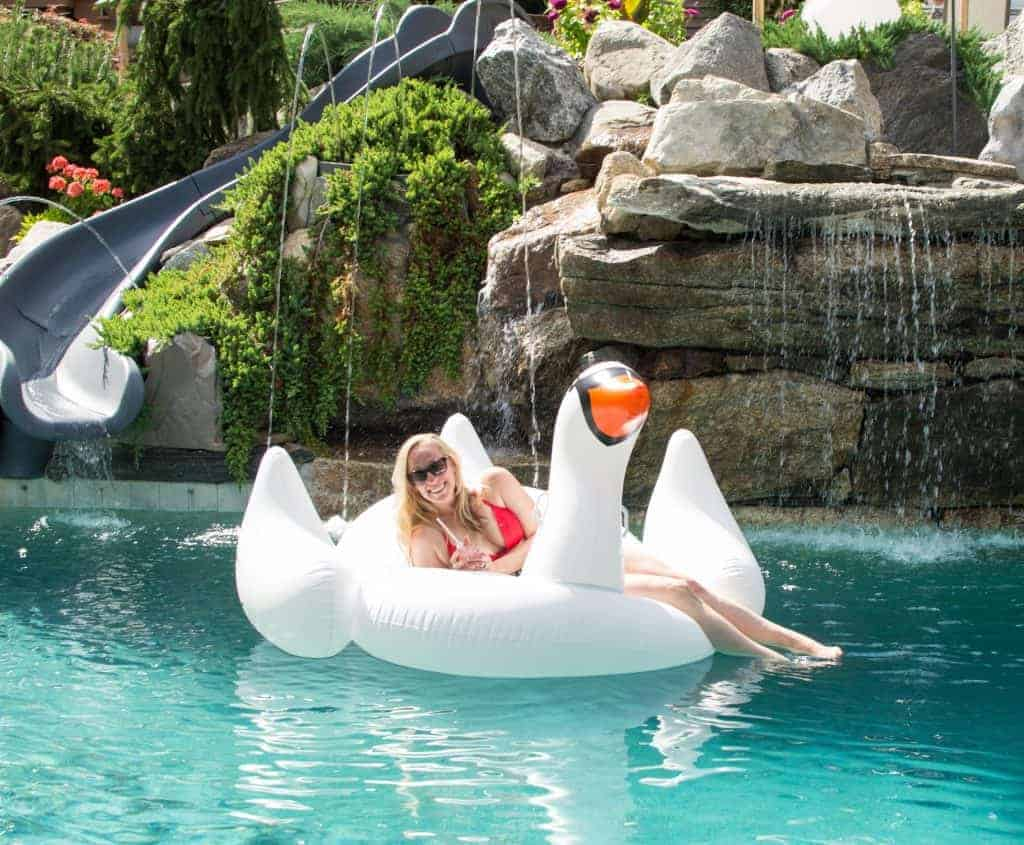 floating on a swan drinking frosé