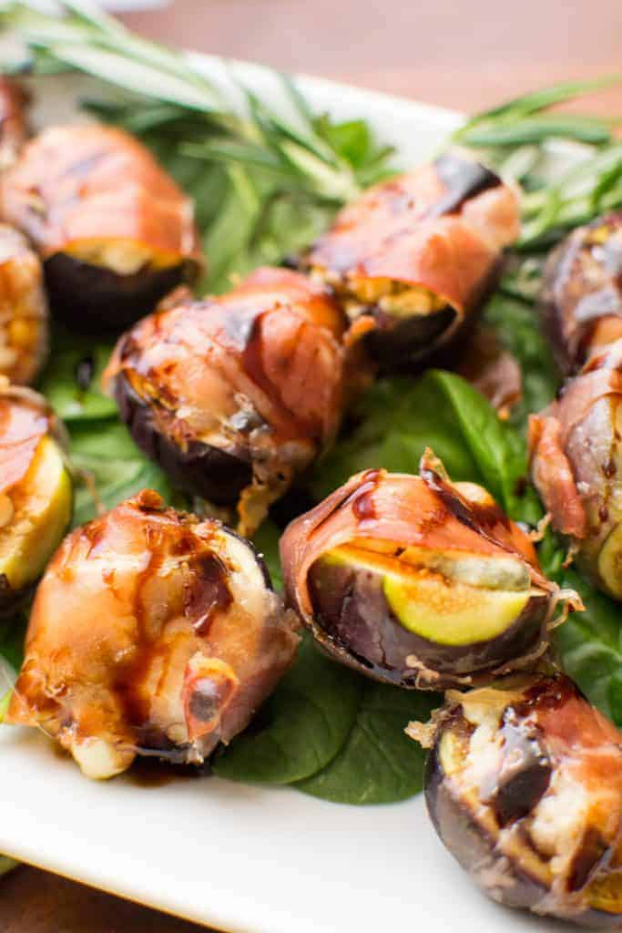 close up of gorgonzola stuffed and prosciutto wrapped figs