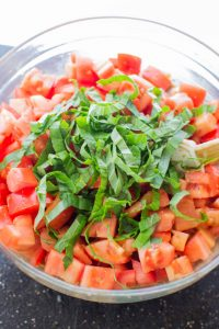 thinly sliced basil is the perfect fresh herb for bruschetta