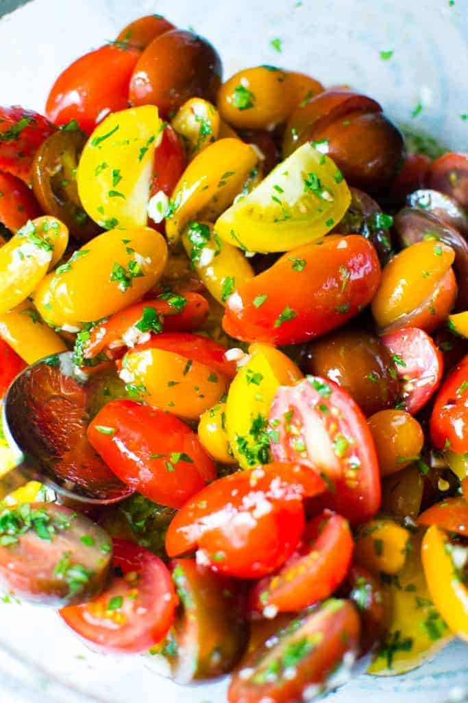 heirloom cherry tomatoes sliced in half, soaked in white wine and garlic