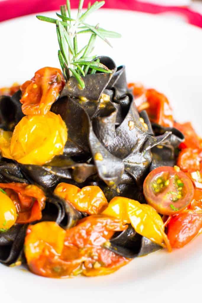 Fresh, handmade squid ink pasta with heirloom tomato sauce