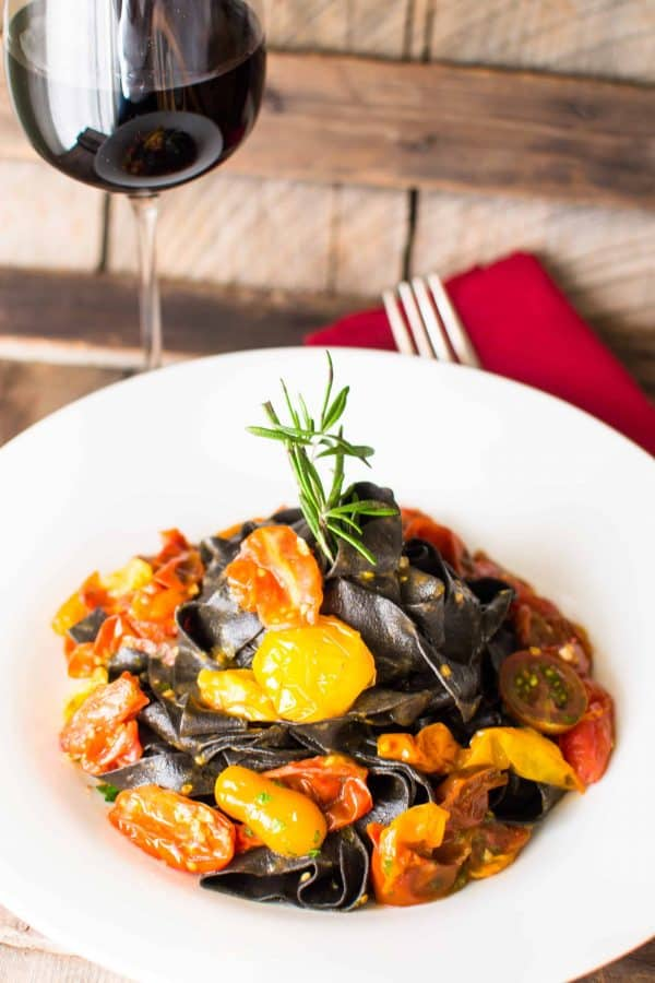 squid ink pasta plated in a large bowl