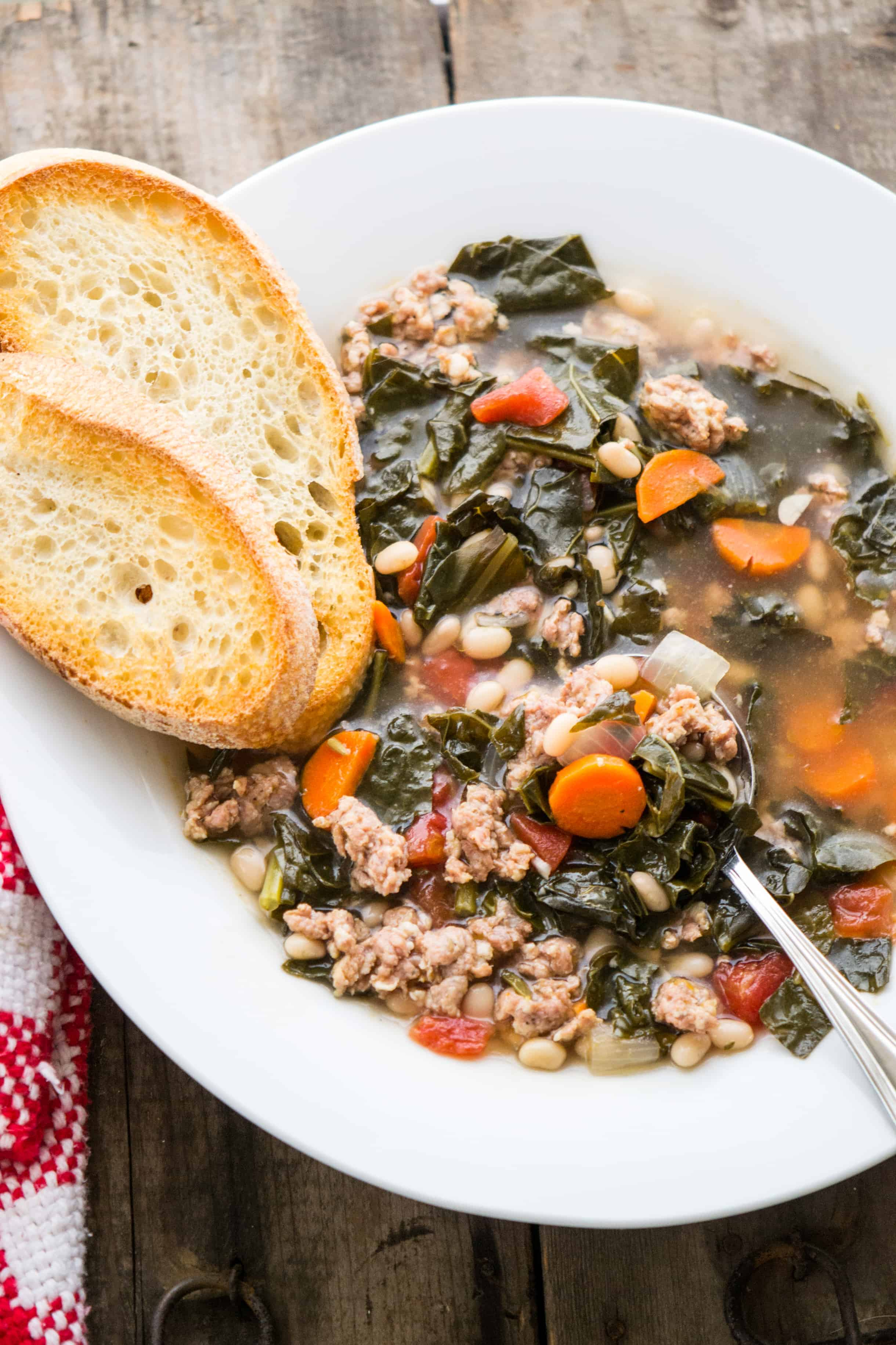 Sweet Italian Sausage, tender White Beans, and rustic Tuscan Kale are the stars in this hearty Italian soup!