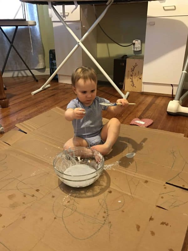toddler playing with oobleck