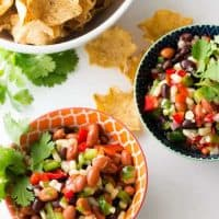 black bean salsa in small bowls with tortilla chips