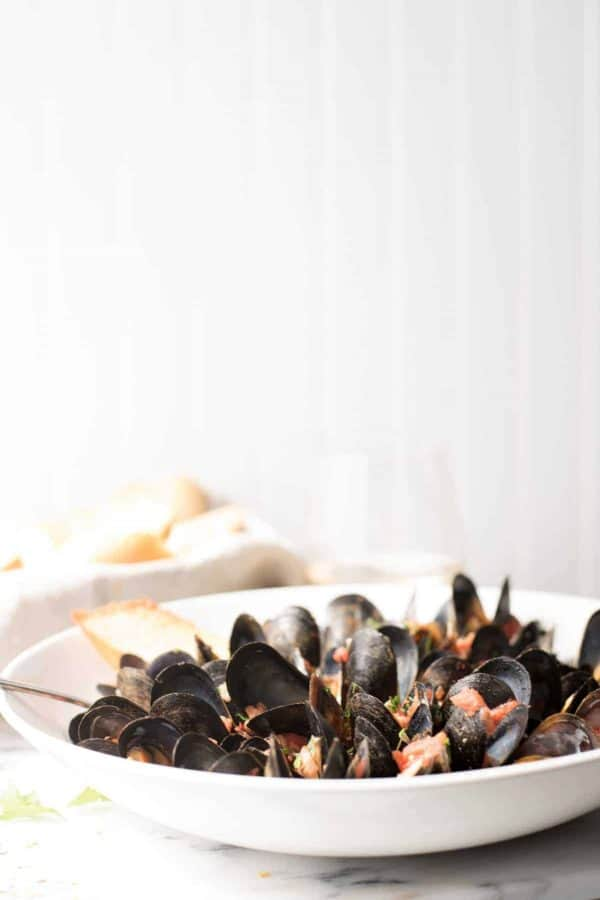 Mussels Fra Diavolo in a bowl with crusty bread