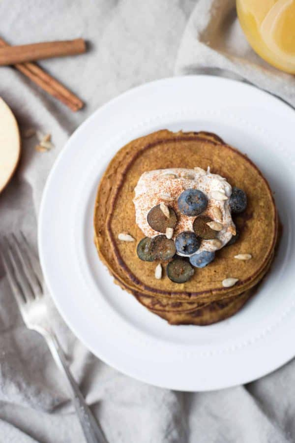 overhead view of pumpkin spice pancakes stacked on a plate