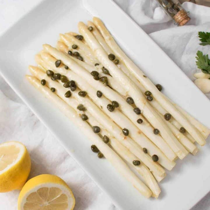 overhead photo of Lemony White Asparagus Piccata on a serving plate