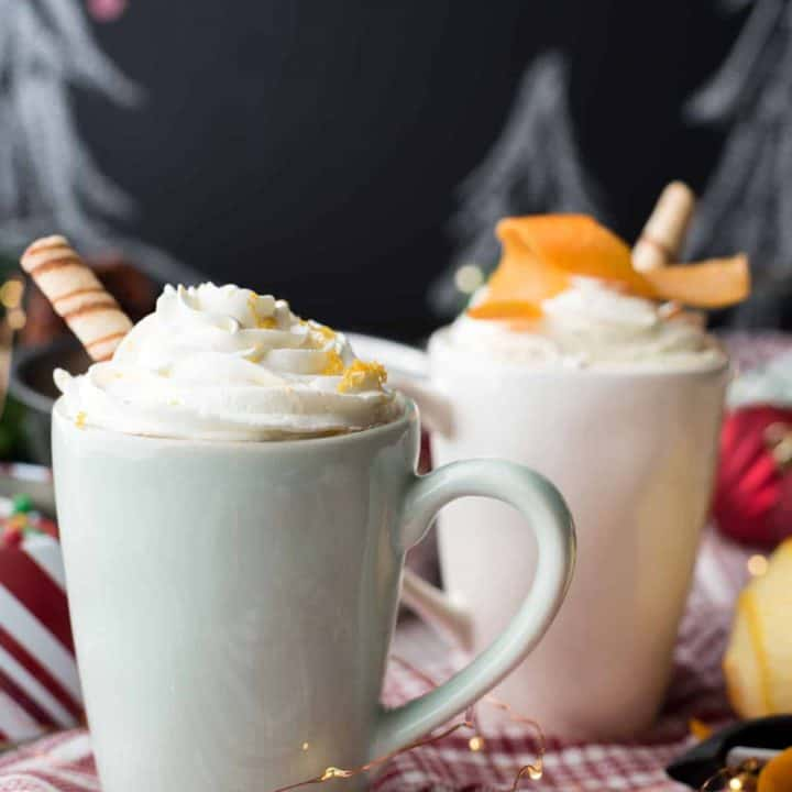 two mugs with whipped cream