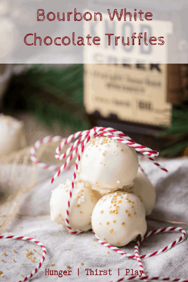 Creamy white chocolate center with warming bourbon flavors and a crunchy chocolate shell. These holiday candies are perfect for gift giving, as stocking stuffers, or to bring to your next holiday party. #holidaycandy #christmasdesserts #bourbonandchocolate