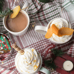 coffee mugs with coffee and whipped cream