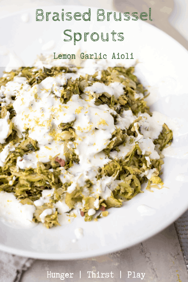 Thinly shaved brussel sprouts make for a super quick side dish by braising them.  Creamy, lemon garlic aioli is the perfect, flavorful topping.  #sidedish #brusselsprouts #aioli