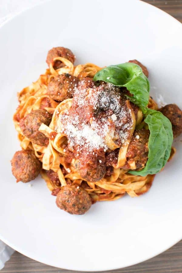 overhead angle of pasta with meatballs and cheese