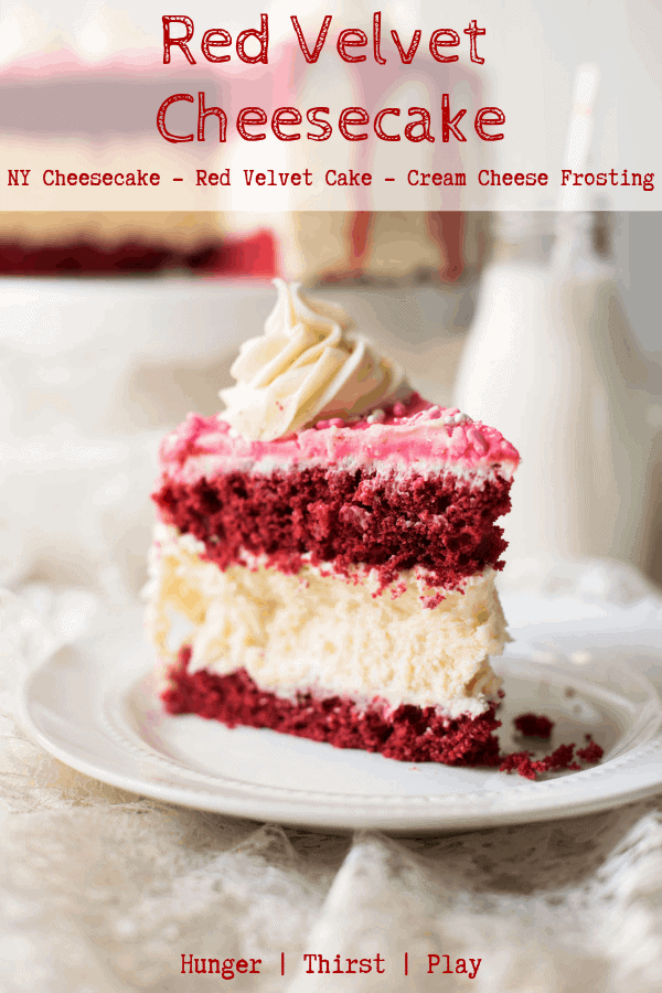 A decadent way to say I Love You on Valentines Day - with cake!  Creamy New York style cheesecake sandwiched between layers of tender red velvet cake decorated with cream cheese frosting. #redvelvetcake #cheesecakerecipes