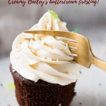 fork slicing into frosting on cupcake