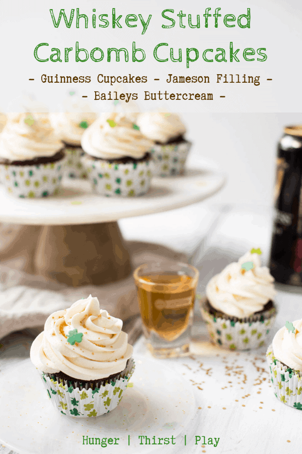 An adult sweet treat for St. Patrick's Day.  Why make a mess chugging a Guinness when you can slowly enjoy it while washing down a delicious cupcake?  Guinness cupcakes stuffed with Jameson filling and a creamy Bailey's buttercream frosting.  #cupcakes #stpatricksday