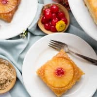 overhead view of a slice of pineapple upside down cake on a plate with a fork
