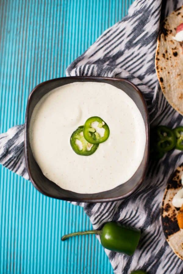 bowl of creamy jalapeño crema sauce for topping tacos