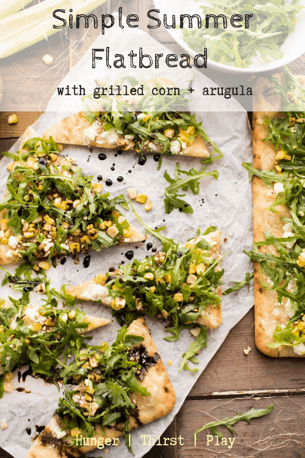 This super quick flatbread is the best for leftover corn on the cob!  Creamy cheese, spicy arugula and sweet corn on a pre-baked flat bread for a super quick appetizer or dinner!  #easyflatbreads #cornonthecob