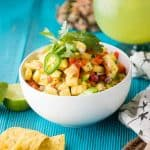 Quick + Crunchy Pineapple Salsa is perfect for a simple upgrade to summer dishes. Sweet fresh pineapple, crunchy bell peppers, and just a small jalapeño kick.