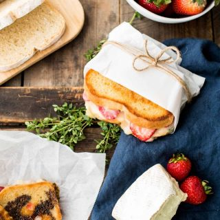 Melty, creamy brie cheese, sweet ripe summer strawberries, and a hint of fresh thyme sandwiched between crisp, buttery country white bread for the ultimate summer grilled cheese.