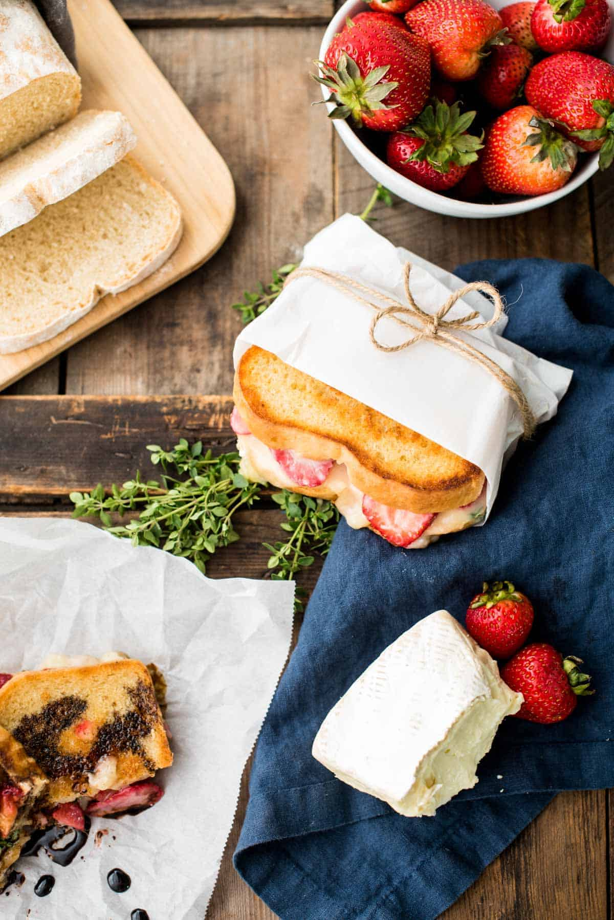 overhead of strawberry brie grilled cheese and ingredients