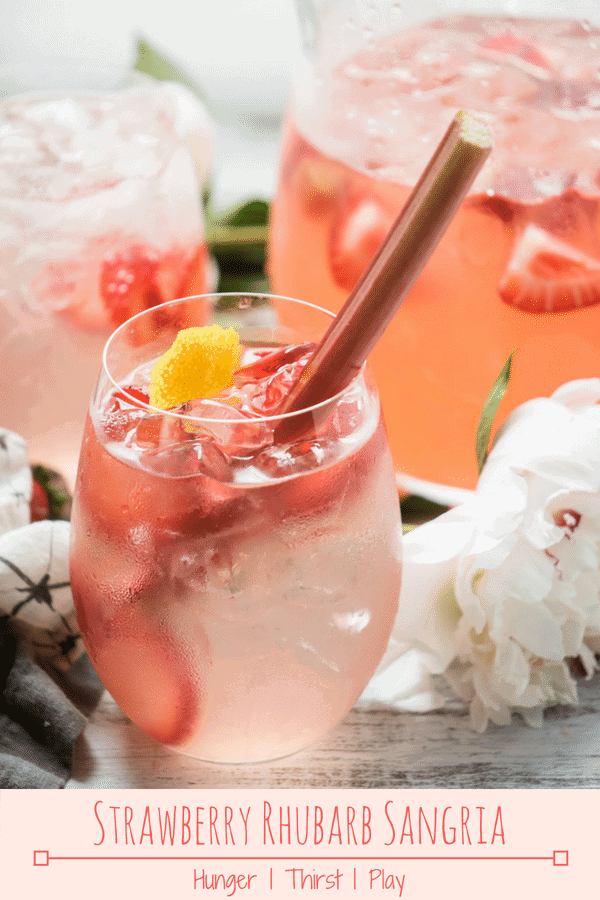 Strawberry Rhubarb Sangria has everything you need in a summertime sangria. Sweet strawberries and crisp rhubarb mingled with dry rosé wine for a sangria that's not too sweet, not too boozy, and ready to sip poolside all day long. #drinks #sangria #strawberryrhubarb #rhubarb #summerdrinks #cocktails