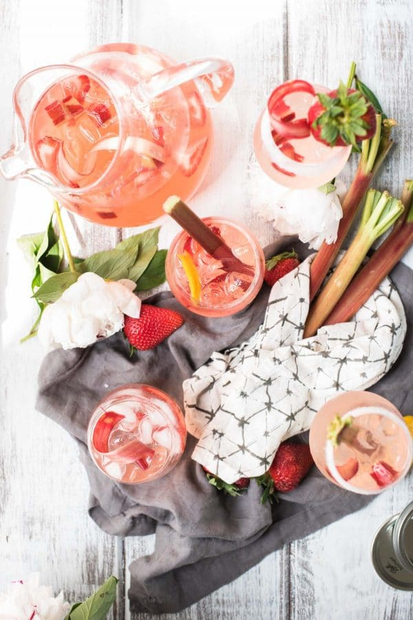 Strawberry Rhubarb Sangria   Sweet strawberries and crisp rhubarb mingle with dry rosé wine for the perfect summertime sangria.