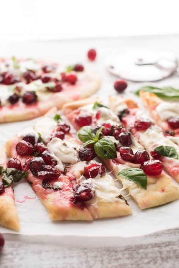 A year round snack that comes together in a pinch! Cranberry Basil Flatbreads are full of fresh, sweet and savory flavors with gooey burrata - perfectly stackable!