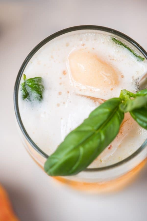 Summery Peach Basil Gin Floats are the perfect cold summer cocktail to cool off in the heat.