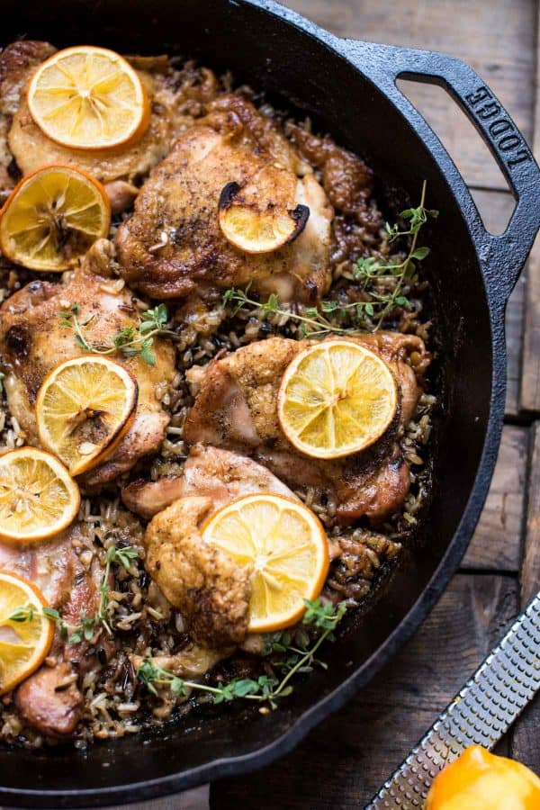 Lemon chicken thighs over wild rice in lodge cast iron pan