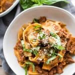 Overhead view of a bowl of lamb ragu with pappardelle pasta