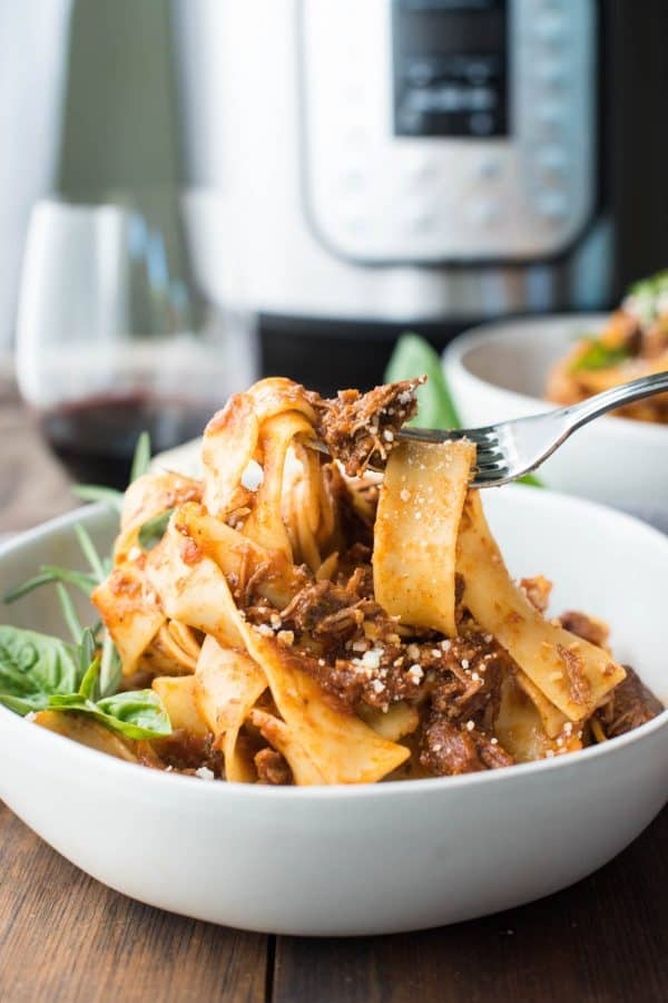 Forkful of pappardelle pasta with instant pot lamb ragu