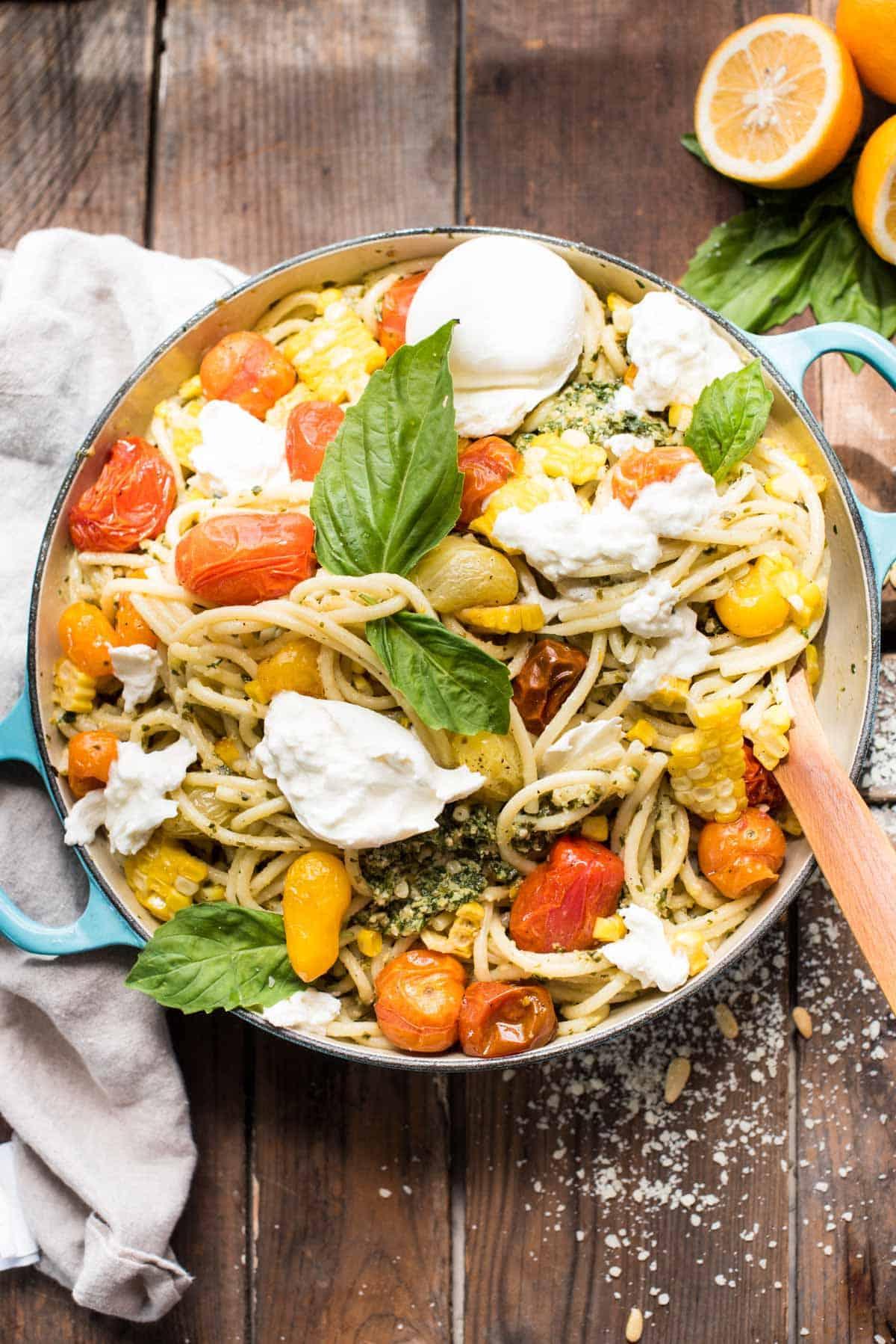Veggie Pesto Pasta with tomatoes, corn, and burrata