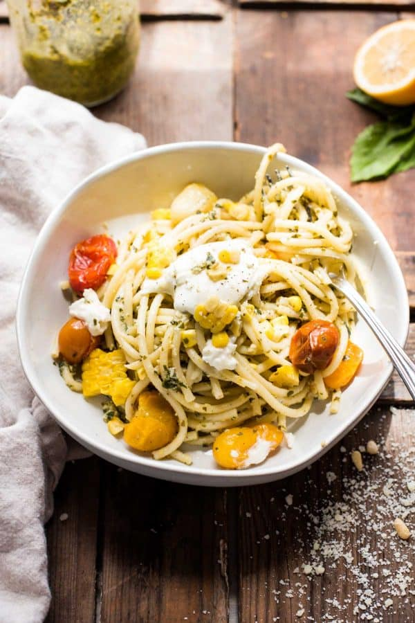 Single serving of veggie Pesto Pasta with tomatoes, corn, and burrata