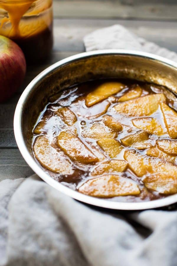 Simmered slices of apple in cinnamon caramel sauce