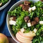 Overhead shot of autumn kale salad served in bowls