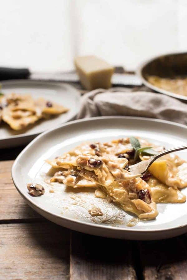 Forkful of marsala cream sauce covered ravioli