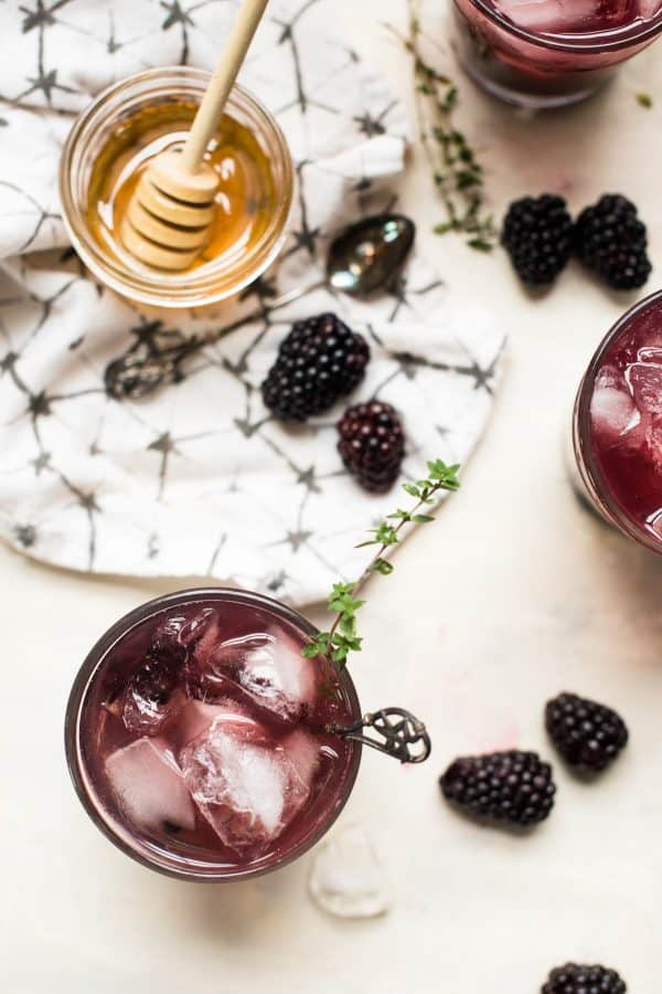 overhead view of blackberry honey bourbon smash cocktail
