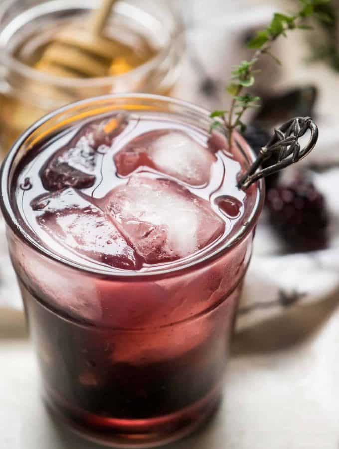 close up of blackberry honey cocktail