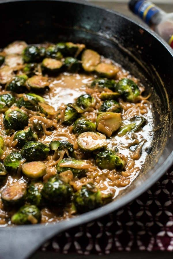 close up of marsala braised brussel sprouts in cast iron