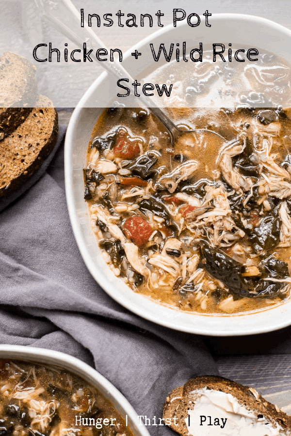 Tender pulled chicken, wild rice, tuscan kale and chopped tomatoes in rich chicken stock cooks up in no time in the Instant Pot. #instantpotsoup #chickenandrice #heartystews