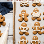 decorated gingerbread cookies on a sheet tray