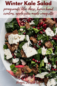 bowl of winter salad with kale and pomegranate