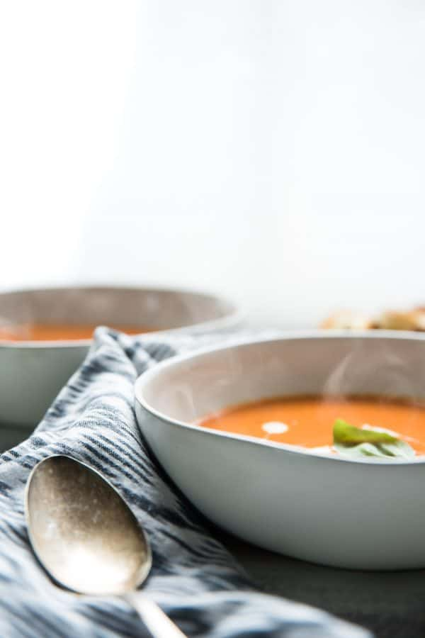 steam escaping from bowls of tomato soup