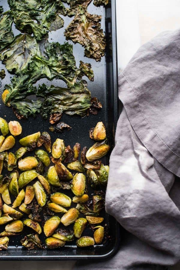 roasted brussels sprouts and crispy kale in a sheet pan