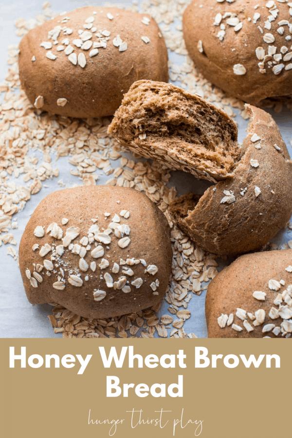 honey wheat brown bread rolls on a sheet tray