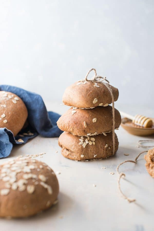 stacked rolls of honey wheat brown bread
