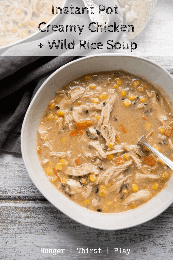Instant Pot Creamy Chicken and Wild Rice Soup is the perfect comfort food soup. Healthy vegetables, hearty wild rice, and pulled chicken in a creamy chicken stock based broth. #instantpot #chickenandrice